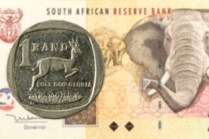 One rand coin and 20 rand note